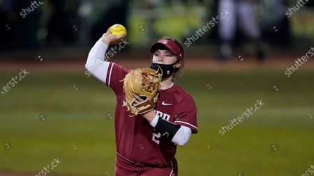 Stanford's Emily Young (2) throws to first base against University of Nevada during an NCAA softball game on in Stanford, Calif
