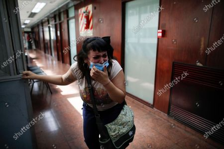 Cecilia Burgos cries outside the courtroom after a judge acquitted former Catholic Priest Carlos Eduardo Jose, citing the statute of limitations had run out on accusations of years of sexual abuse of Mailin Gobbo when she was an adolescent, in San Martin, Argentina, . Burgos says she was sexually abused by the 62-year-old as well