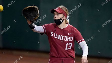 Stock Image of Stanford's Emily Schultz (13) catches a throw at first base against University of Nevada during an NCAA softball game on in Stanford, Calif