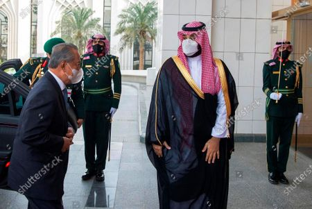 Stock Image of In this photo released by Saudi Press Agency, SPA, Saudi Crown Prince Mohammed bin Salman, right, accompanies Malaysian Prime Minister Muhyiddin Yassin, in Riyadh, Saudi Arabia