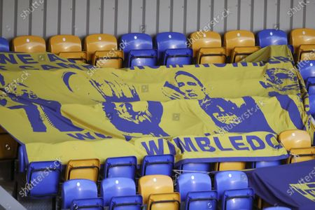 Stock Photo of Banner in stands showing Vinnie Jones during the EFL Sky Bet League 1 match between AFC Wimbledon and Burton Albion at Plough Lane, London