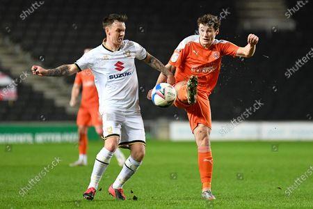 Milton Keynes Dons midfielder Josh McEachran (5)  battles for possession  with Blackpool midfielder Matty Virtue (17) during the EFL Sky Bet League 1 match between Milton Keynes Dons and Blackpool at stadium:mk, Milton Keynes