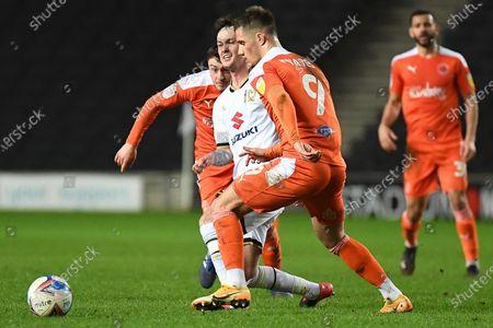 Milton Keynes Dons midfielder Josh McEachran (5) battles for possession with Blackpool forward Jerry Yates (9) during the EFL Sky Bet League 1 match between Milton Keynes Dons and Blackpool at stadium:mk, Milton Keynes