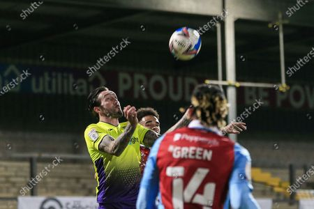 Ryan Bowman (12) of Exeter City heads the ball during the EFL Sky Bet League 2 match between Scunthorpe United and Exeter City at the Sands Venue Stadium, Scunthorpe
