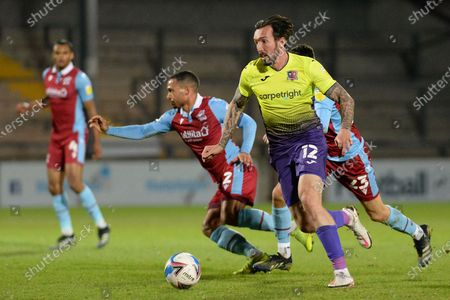 Exeter City Ryan Bowman (12) attacking during the EFL Sky Bet League 2 match between Scunthorpe United and Exeter City at the Sands Venue Stadium, Scunthorpe