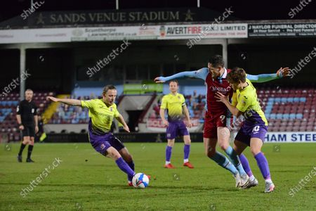 Scunthorpe United Ryan Loft (9) Exeter City Archie Collins (10) battles for possession during the EFL Sky Bet League 2 match between Scunthorpe United and Exeter City at the Sands Venue Stadium, Scunthorpe