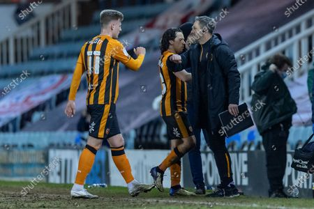 Hull City forward James Scott (11) is congratulated by one of the coaching team at the end of the EFL Sky Bet League 1 match between Peterborough United and Hull City at London Road, Peterborough