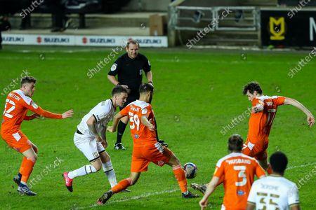 Josh McEachran of Milton Keynes Dons has his pass into the box blocked by Matty Virtue of Blackpool