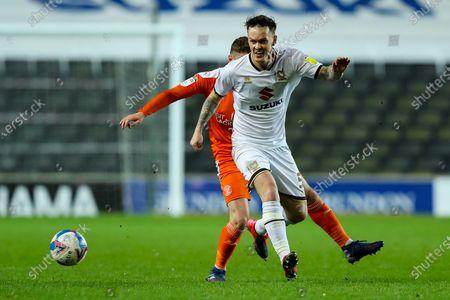Josh McEachran of Milton Keynes Dons protects the ball