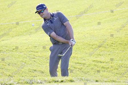 Zach Johnson of the US chips on the fifth hole during a practice round for THE PLAYERS Championship golf tournament at TPC Sawgrass, in Ponte Vedra Beach, Florida, USA, 09 March 2021.