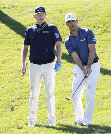 Brandt Snedeker of the US (L) watches Billy Horschel of the US chips on the fifth hole during a practice round for THE PLAYERS Championship golf tournament at TPC Sawgrass, in Ponte Vedra Beach, Florida, USA, 09 March 2021.