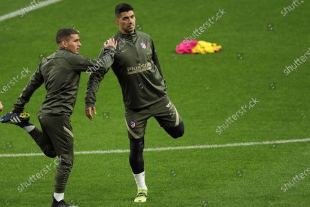 Atletico de Madrid's Luis Suarez and Lucas Torreira (L) attend a team's training session at Wanda Metropolitano Sports City in Madrid, Spain, 09 March 2021, on the eve of their Spanish LaLiga soccer match against Athletic Club de Bilbao.