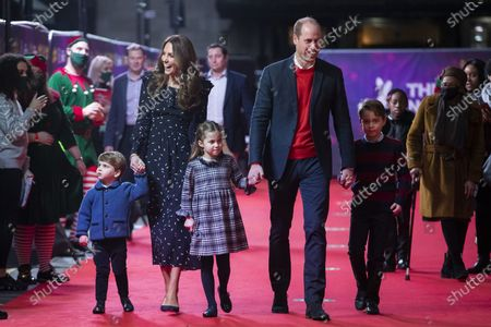 Britain's Prince William and Kate, The Duke and Duchess of Cambridge and their children, Prince Louis, left, Princess Charlotte and Prince George arrive for a special pantomime performance at London's Palladium Theatre. One of the most dramatic claims in Prince Harry and Meghan's interview with Oprah Winfrey was that their son was denied a royal title, possibly because of the color of his skin. Queen Elizabeth II has nine great-grandchildren, including Archie. They are not princes and princesses, apart from the three children of Prince William, who is second in line to the throne and destined to be king one day