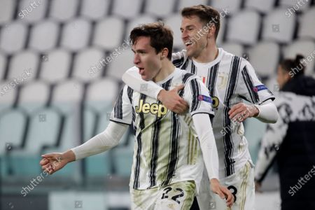 Juventus' Federico Chiesa celebrates with' Aaron Ramsey, right, after scoring his side's second goal during the Champions League, round of 16, second leg, soccer match between Juventus and Porto in Turin, Italy
