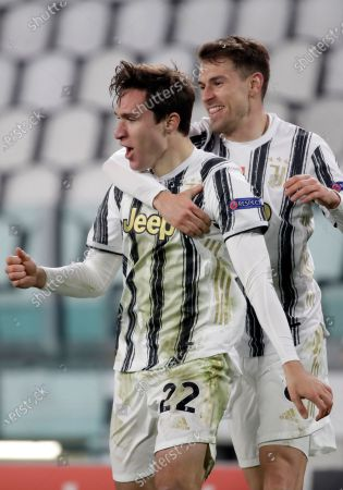 Juventus' Federico Chiesa celebrates with Aaron Ramsey, right, after scoring his side's second goal during the Champions League, round of 16, second leg, soccer match between Juventus and Porto in Turin, Italy