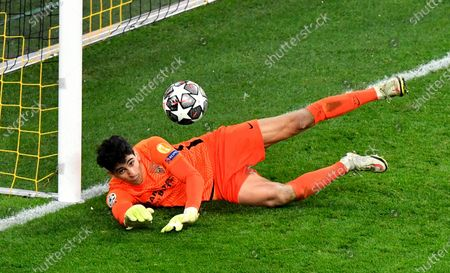 Sevilla's goalkeeper Yassine Bono makes a save during the Champions League, round of 16, second leg soccer match between Borussia Dortmund and Sevilla FC in Dortmund, Germany