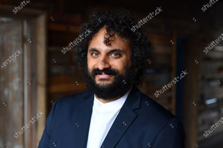 Stock Image of British entertainer Nish Kumar on set in London, filming a specially commissioned programme to accompany this year's Sony World Photography Awards 2021 virtual exhibition. The film introduces the big winners from around the world, the film and exhibition will be available to view from 15 April 2021 at worldphoto.org.