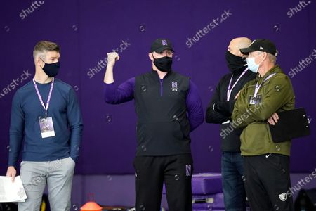Northwestern head coach Pat Fitzgerald, center, talks with Chicago Bears general manager Ryan Pace, left, Las Vegas Raiders general manager Mike Mayock, right, and Bears head coach Matt Nagy, during the school's Pro Day football workout for NFL scouts, in Evanston, Ill