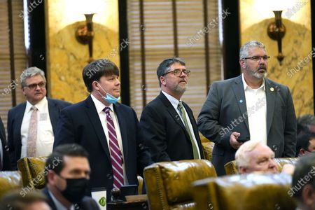 Republican Representatives, from left, Kevin Horan of Grenada, Joey Hood of Ackerman, Jay McKnight of Gulfport, and Brent Anderson of Bay St. Louis, observe the vote on the electronic tally board at the Capitol in Jackson, Miss., . Lawmakers have a Wednesday deadline for original floor action on general bills and constitutional amendments originating in the other House