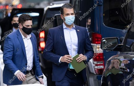 Donald Trump Jr. (R), the son of former US President Donald J. Trump, walks to his father's motorcade outside of Trump Tower in New York, New York, USA, 09 March 2021. Former President Trump arrived a day earlier for a short visit to his apartment in New York.