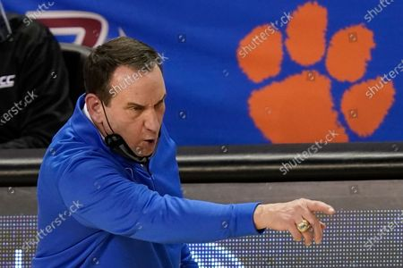 Stock Image of Duke head coach Mike Krzyzewski directs his team during the second half of an NCAA college basketball game against Boston College in the first round of the Atlantic Coast Conference tournament in Greensboro, N.C