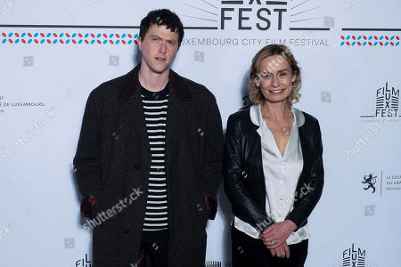 (L-R) Actors Finnegan Oldfield and Sandrine Bonnaire attend the 11th Luxembourg city film festival jury photocall at Hotel Du Louvre