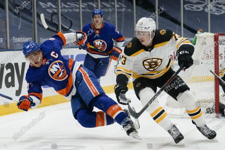 Stock Picture of Boston Bruins' Charlie McAvoy (73) fights for position with New York Islanders' Anders Lee (27) during the second period of an NHL hockey game, in Uniondale, N.Y