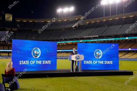 California Gov. Gavin Newsom delivers his State of the State address from Dodger Stadium as his wife Jennifer Siebel Newsom listens, in Los Angeles