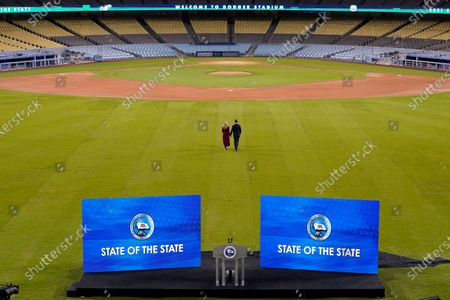 California Gov. Gavin Newsom and his wife Jennifer Siebel Newsom walk away from the stage after he delivered his State of the State address from an empty Dodger Stadium, in Los Angeles
