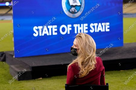 Jennifer Siebel Newsom waits for her husband, California Gov. Gavin Newsom, to deliver his State of the State address from Dodger Stadium, in Los Angeles