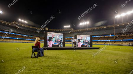Stock Image of Jennifer Siebel Newsom, left, First Partner of California Gov. Gavin Newsom, watches Gov. Gavin Newsom deliver his third State of the State address to the Legislature and public virtually from en empty Dodger Stadium in Los Angeles Tuesday, March 9, 2021. There is no in-person audience at the outdoor location and public health guidelines are strictly observed. Photo taken at Dodger Stadium on Tuesday, March 9, 2021 in Los Angeles, CA.