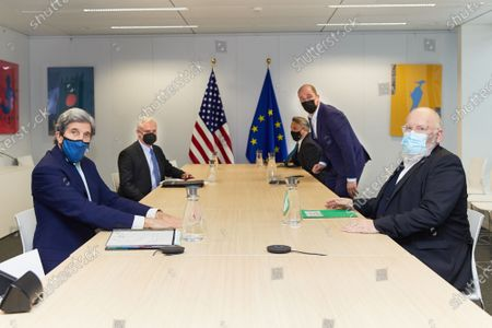 European Commission Executive Vice-President Frans Timmermans (1st R) meets with John Kerry (1st L), the United States' Special Presidential Envoy for Climate, in Brussels, Belgium, March 9, 2021.   John Kerry on Tuesday underlined the cooperation between the U.S. and European Union (EU) on the fight against the climate crisis during his visit to Brussels.