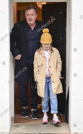 **Permission granted for daughter to be photographed** © Licensed to London News Pictures. 10/03/2021. London, UK. Former Good Mooring Britain host Piers Morgan leaves his London home with his daughter ELISE the morning after resigning over comments he made about The Duchess of Sussex, Meghan Markle.