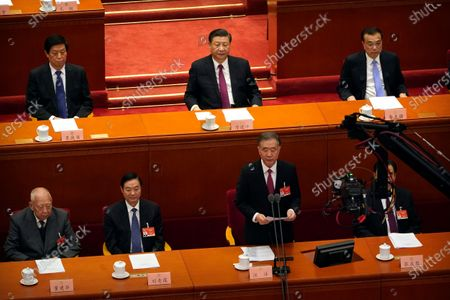 Chinese President Xi Jinping, top row center, listens as Wang Yang, chairman of the Chinese People's Political Consultative Conference (CPPCC), speaks during the closing session of the CPPCC at the Great Hall of the People in Beijing