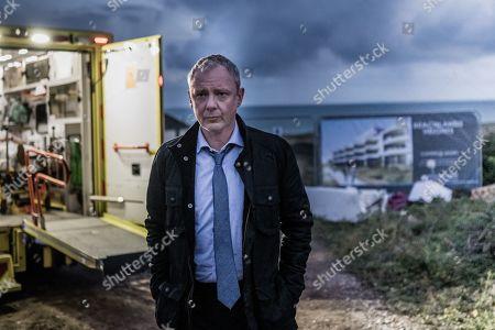 John Simm as DS Roy Grace.