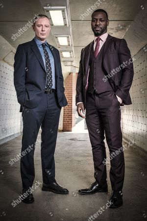 John Simm as DS Roy Grace and Richie Campbell as DS Branson.