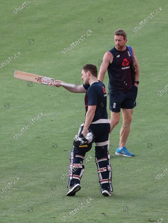 Stock Image of England's captain Eoin Morgan, front interacts with Assistant Coach Paul Collingwood during a training session ahead of the first Twenty20 cricket match between India and England in Ahmedabad, India