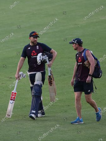 England's Dawid Malan, left, interacts with Assistant Coach Paul Collingwood during a training session ahead of the first Twenty20 cricket match between India and England in Ahmedabad, India