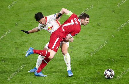 James Milner of Liverpool and Hee-Chan Hwang of RB Leipzig