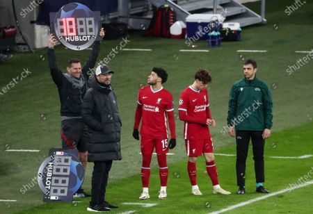 Stock Image of Jurgen Klopp manager of Liverpool beside Alex Oxlade-Chamberlain of Liverpool and Kostas Tsimikas of Liverpool as they want to come on as a substitute