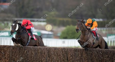 Fortescue (Richard Johnson,right) jumps the last fence and beats Debece (Harry Skelton) in the 3m handicap chaseSandown 13.3.21 Pic: Edward Whitaker