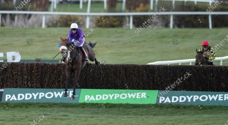Five Star Getaway (Nick Scholfield) jumps the last fence and wins the 2m 4f handicap chaseSandown 13.3.21 Pic: Edward Whitaker