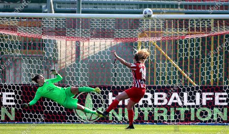 Atletico Madrid's Toni Duggan (R) misses a penalty during the UEFA Women's Champions League round of 16, second leg soccer match between Atletico Madrid and Chelsea FC at Brianteo stadium in Monza, Italy, 10 March 2021.