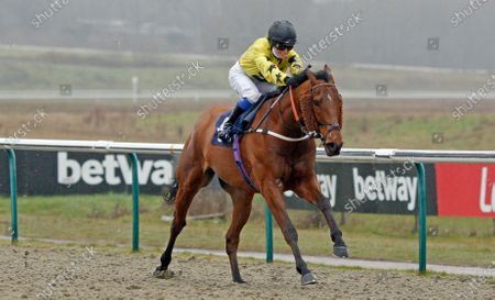 Stock Photo of GAVI DI GAVI (Georgia King) wins The Bombardier March To Your Own Drum Handicap Lingfield