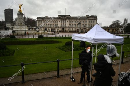Media outside Buckingham Palace in London, Britain, 10 March 2021. US channel CBS aired a television interview with Britain's Prince Harry and Meghan, Duke and Duchess of Sussex on 07 March. Buckingham Palace have responded with a statement to the racism allegations following the TV interview that was broadcast in the UK on 08 March.