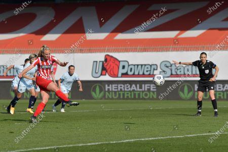 Stock Image of Toni Duggan (#18 Atletico de Madrid) kicks and misses the penalty