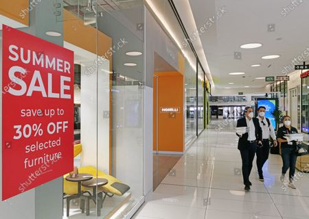 A discount sign is seen at a mall in Johannesburg, South Africa, March 10, 2021. South Africa's gross domestic product (GDP) recorded a 1.5 percent growth in the fourth quarter of 2020, and expanded 6.3 percent quarter on quarter on a seasonally adjusted and annualized basis in the same quarter, Statistics South Africa (Stats SA) data showed on Tuesday.    Manufacturing and trade has helped lift growth in the fourth quarter, according to the Stats SA.    However, the positive growth recorded in the third and fourth quarters was not enough to offset the devastating impact of COVID-19 in the second quarter when lockdown restrictions were at their most stringent, it said, adding that economic activity for 2020 decreased by 7 percent compared to 2019.