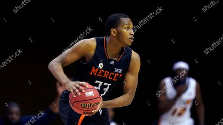 Mercer forward James Glisson III (23) looks to pass the ball against UNC-Greensboro in the first half of an NCAA men's college basketball championship game for the Southern Conference tournament, in Asheville, N.C