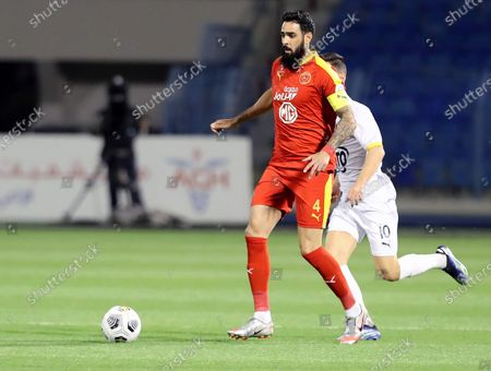 Al-Qadisiyah's player Rhys Williams (L) in action against Al-Ain's Juanpi Anor (R) during the Saudi Professional League soccer match between Al-Qadisiyah and Al-Ain at Prince Mohammed Bin Fahd Stadium, in Dammam, Saudi Arabia, 10 March 2021.