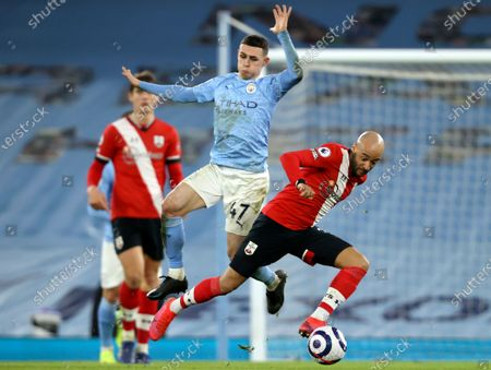 Southampton's Nathan Redmond (R) in action against Manchester City's Phil Foden (L) during the English Premier League soccer match between Manchester City and Southampton FC in Manchester, Britain, 10 March 2021.